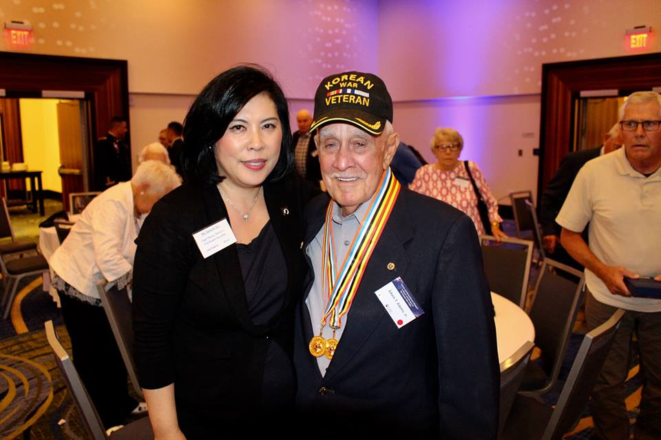 My friend Susan Kee (above) dedicates her time and energy to  honoring Korean War veterans.  Here she is shown with Korean War veteran Mr. Edwin Adams, the brother of Cpl. Charles W. Adams, US Army, who also fought in the Korean War and became missing in action in 1950. His remains have never been recovered.  Click on the picture above to learn more about this story.   (Photo Credit: Susan Kee)