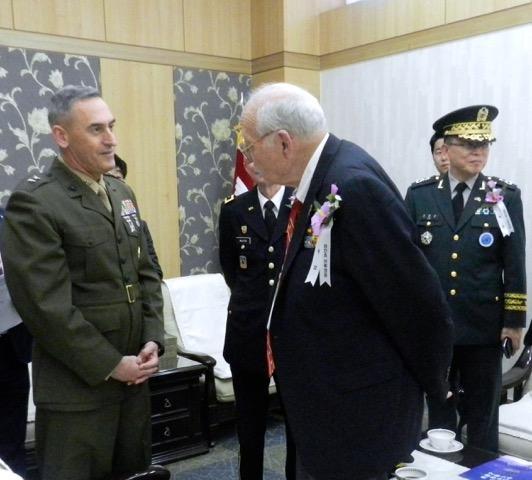 Major General James W. Lukeman, Commander of US Marine Corps Forces Korea, with Jean White, Chosin veteran